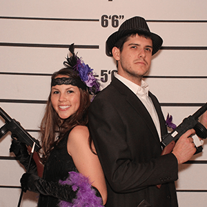 Phoenix Murder Mystery party guests pose for mugshots
